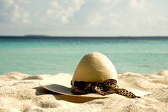 Women's sun hat on the sand Stock Image