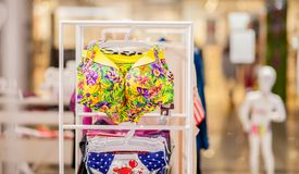 Women`s swimsuits for sale at a seaside shop. Advertise, Sale, Fashion concept.  stock photography