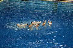 Women's synchronized swimming in the pool Royalty Free Stock Photography