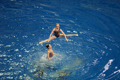 Women's synchronized swimming in the pool Stock Photo