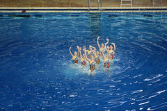 Women's synchronized swimming in the pool Royalty Free Stock Photo