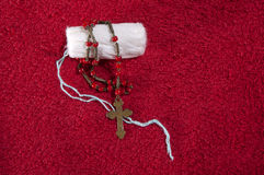 Women's tampon and rosary. Wrapped women's tampon and rosary stock images