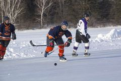 Women`s teams compete in a Pond Hockey Festival in Rangeley. Royalty Free Stock Image