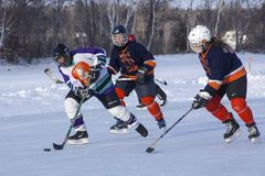 Women`s teams compete in a Pond Hockey Festival in Rangeley. Royalty Free Stock Images