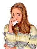 Women's tears. The reasons may be different. Colds. Portrait of crying young nice girl with a handkerchief. The reasons may be different. Colds, allergies or Royalty Free Stock Image