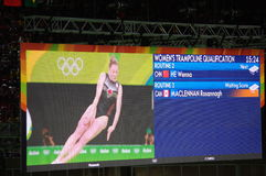 Women's trampoline qualification at Rio2016. Screen showing awaiting score for Canada's Rosie MacLennan after routine 2 of qualification round in Rio2016 women Stock Images