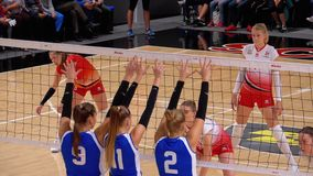 Women`s volleyball championship. Match of super league with spectators indoor. Slow motion