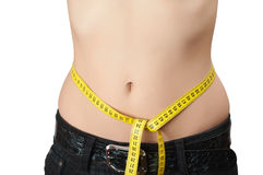Women's waist with a measuring tape Stock Images