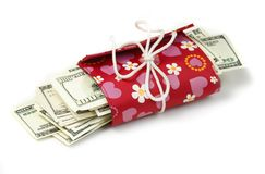 Women's wallet with thousand dollars inside Royalty Free Stock Photo