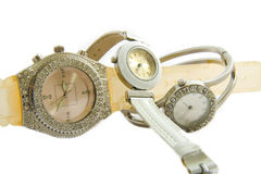 Women's watches. Pile of watches on a white background Royalty Free Stock Images