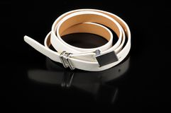 Women's White Leather Belt on Black Background Royalty Free Stock Image
