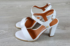 Women's white sandals  on  floor Royalty Free Stock Image