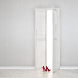 Women's white shoe near of the open door Royalty Free Stock Photography