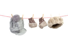 Women's winter accessories on the clothesline Royalty Free Stock Photography