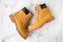 Women`s winter boots. Yellow warm boots for trekking.  Stock Image