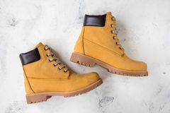 Women`s winter boots. Yellow warm boots for trekking.  Stock Photo