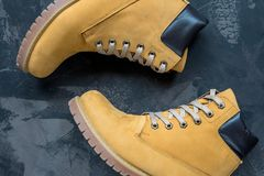 Women`s winter boots. Yellow warm boots for trekking.  Royalty Free Stock Images
