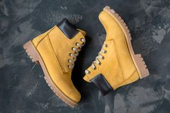 Women`s winter boots. Yellow warm boots for trekking.  Stock Photos