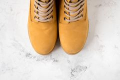 Women`s winter boots. Yellow warm boots for trekking.  Royalty Free Stock Photos