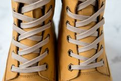 Women`s winter boots. Yellow warm boots for trekking.  Stock Images