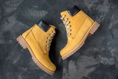 Women`s winter boots. Yellow warm boots for trekking.  Stock Photography