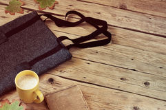 Women's woolen bag with a cup of latte Royalty Free Stock Photo