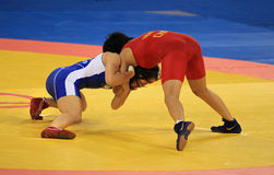 Women's Wrestling competition. BEIJING-SEP 01: Panpan Yang of China (R) fights against Stacie Anaka of Canada (L) during the Wrestling competitions of the Stock Images