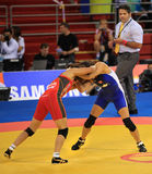 Women's Wrestling competition. BEIJING-SEP 01: Chikako Matsukawa of Japan (L)  fights against Brittanee Laverdure of Canada (R) during the Wrestling competitions Stock Photography
