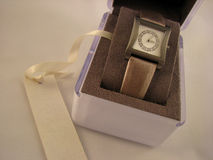 Women's wristwatch with gemstones. Inside and a ribbon with a gift card Stock Photography