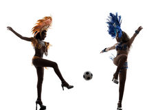 Women samba dancer playing soccer silhouette Stock Images