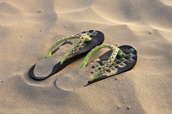 Women sandals. On brown sand Stock Photography
