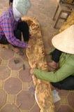 Women sanding sculpture Stock Photography