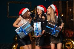 Women in santa claus hat with gift in hands. stock images