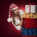 Women with Santa hat with presents isolated Stock Photography