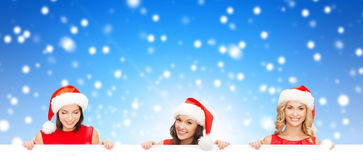 Women in santa helper hat with blank white board Stock Photos