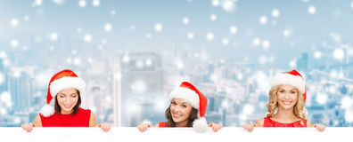 Women in santa helper hat with blank white board Royalty Free Stock Photos