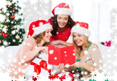Women in santa helper hats with card and gifts Royalty Free Stock Photography