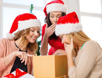 Women in santa helper hats with many gift boxes Stock Photography