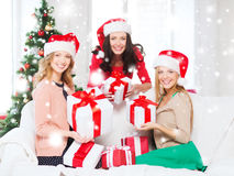Women in santa helper hats with many gift boxes Royalty Free Stock Photo