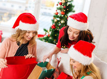 Women in santa helper hats with shopping bags Royalty Free Stock Images