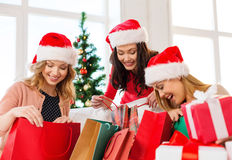 Women in santa helper hats with shopping bags Stock Photo