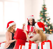 Women in santa helper hats with shopping bags Royalty Free Stock Photo