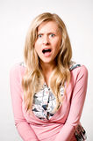Women with scared expresion. On her face Stock Images