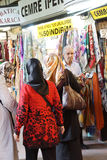 Women with scarves shopping for silk Royalty Free Stock Image