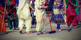 Women while scavenging the street  during a Sikh festival Royalty Free Stock Image