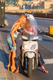 Women with a scooter in Florence, Italy stock photos
