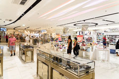 Women Searching For Luxury Perfume In Shopping Mall Interior Royalty Free Stock Photography