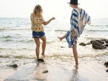 Women on Seashore Stock Image