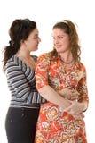 Women secrets. Two beautiful girls talking about women secrets Stock Photo