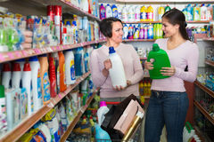 Women selecting detergents in store Stock Photography